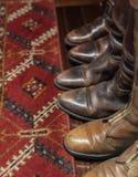 Läderkängor och matta Royaltyfri Foto