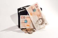 Läderplånbok och pengar arkivfoton