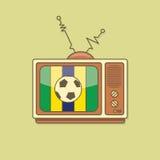 Lägenhet stiliserad fotbollboll på TV Brasilien flaggafärg Arkivbild