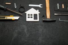 Lägenhetreparation, huskonstruktionsbegrepp Kopiera utrymme f?r text royaltyfri fotografi