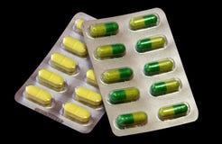 Läkarundersökning för vitaminpreventivpillerkapsel Arkivbilder