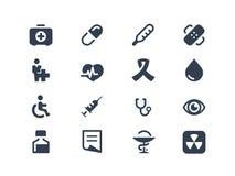 Läkarundersökning- och sjukvårdsymboler Arkivfoton