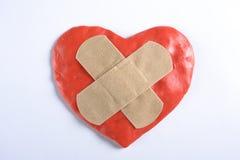 Läkarundersökningen för hjärta vith tejpar arkivbilder