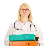 Läkarundersökningen manipulerar med ett raddaarbete Royaltyfri Foto