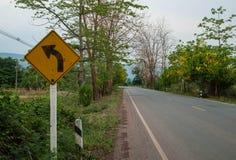 Lämnad vänd för trafiktecken arkivfoto