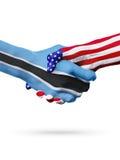 Länder för flaggor Botswana och Förenta staterna, överexponerad handskakning Arkivfoto
