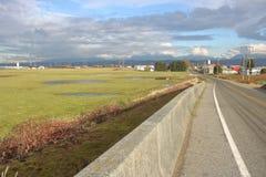Ländliche landwirtschaftliche Straße in Richmond, Kanada Lizenzfreie Stockfotos
