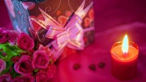 Längd i fot räknat av blommabouqet, stearinljusbränningen och garneringvalentin