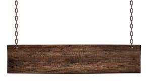 Längliches hölzernes Brett hergestellt vom dunklen Holz, das auf Ketten hängt stockfoto