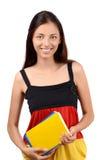 Lär tysk. Den härliga studenten med innehavet för Tysklandflaggablusen bokar. Arkivbild