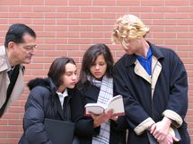 Lärare & deltagare arkivbilder