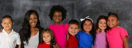 Lärare And Her Students royaltyfri foto
