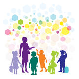 Lärare och barn Arkivbild