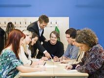 Lärare och deltagare arkivbilder
