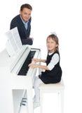 Lärare och student på pianot Arkivbilder