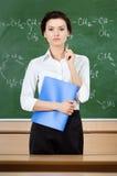 Lärare på blackboarden arkivbild