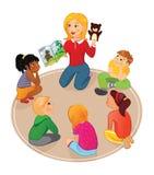 Läraren läser en sagobok till ungar och showdockan Arkivbilder