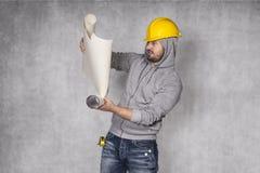 Läs- byggnadsplan för arbetare Royaltyfri Fotografi