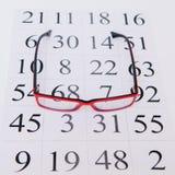 Läs- glasögon och ögondiagram Royaltyfri Foto