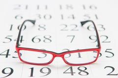 Läs- glasögon och ögondiagram Arkivfoto
