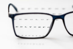 Läs- svart glasögon och närbild för ögondiagram Fotografering för Bildbyråer