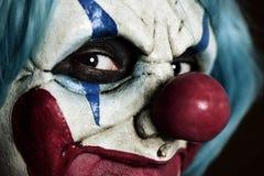Läskig ond clown arkivbild