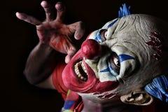 Läskig ond clown royaltyfri fotografi