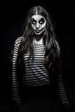 Läskig ond clownflicka arkivfoton