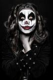 Läskig ond clownflicka royaltyfria bilder