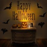 Läskiga halloween pumpor och stearinljus Arkivbild