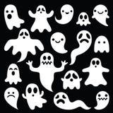 Läskiga vita spökar planlägger på svart bakgrund - allhelgonaaftonberöm Royaltyfria Bilder