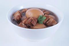 Lät småkoka griskött och ägg Royaltyfri Fotografi