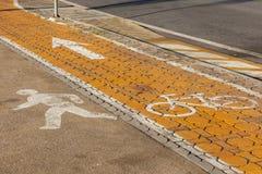 Läufer auf Fahrrad Stockbild