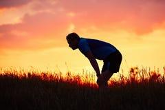 Läufer bei dem Sonnenuntergang Stockbilder