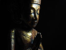 Låga nyckel- guld- buddha nummer 2 Royaltyfri Fotografi