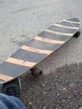 Lång brädeskateboard arkivbild