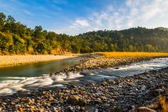 Lång exponering av flödande vatten Fotografering för Bildbyråer