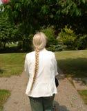 lång pigtail för hår arkivbild