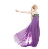 lång purpur kvinna för härlig klänning Royaltyfri Fotografi