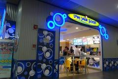 Lång restaurang för John Silver ` som s lokaliseras i Singapore Royaltyfri Bild
