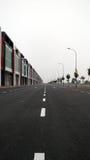 lång väg straight Arkivfoto