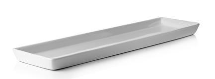 Lång vit platta som isoleras på en vit bakgrund royaltyfri foto