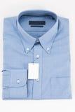 långa skjortamuffar för blå krage Arkivfoton