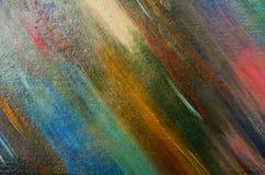 Långa sudd av en mörk vattenfärgmålarfärg Arkivfoto