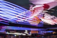 Långt exponeringsfotografi Karusellljus och förehavanden, UK arkivfoto