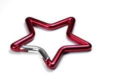 lås den metall formade stjärnan Arkivbild