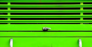 Lås på den gröna bussen Arkivbild
