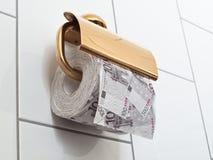 låt paper s toalettbruk för pengar Arkivbilder