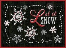 Låtet det att snöa blänker snöflingor på den svarta svart tavlan Royaltyfri Fotografi