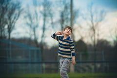 Låtsa för Austistic pojke Royaltyfria Bilder